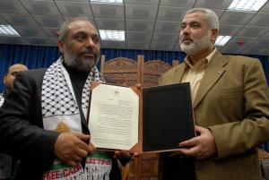 IHH president Bulent Yildirim with Hamas' Ismail Haniyeh