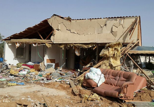 A house in Be'er Sheva after a missile hit on 13/7/14. Photo credit: IDF