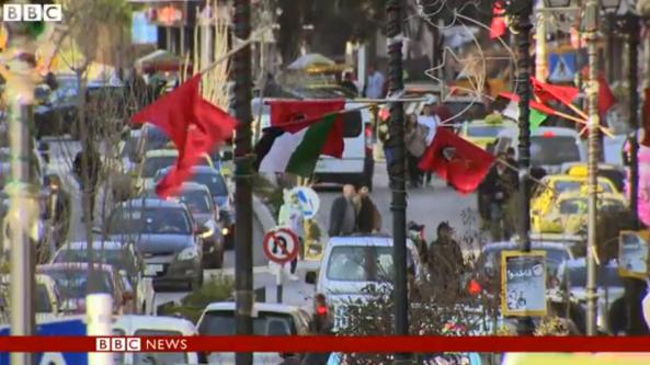 Doucet filmed 18 3 DFLP flags